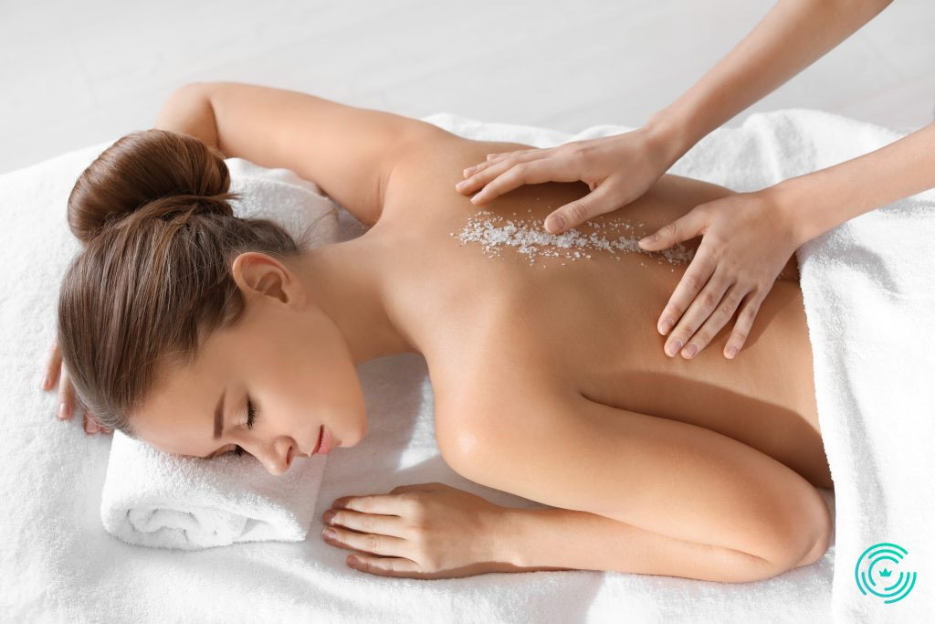 Young woman having salt massage