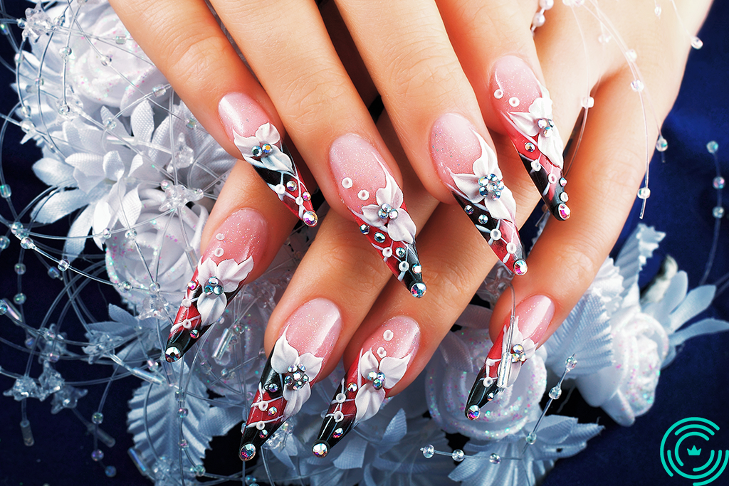 Woman's hand with long, sharp nails, floral pattern, with shades of white, red and black