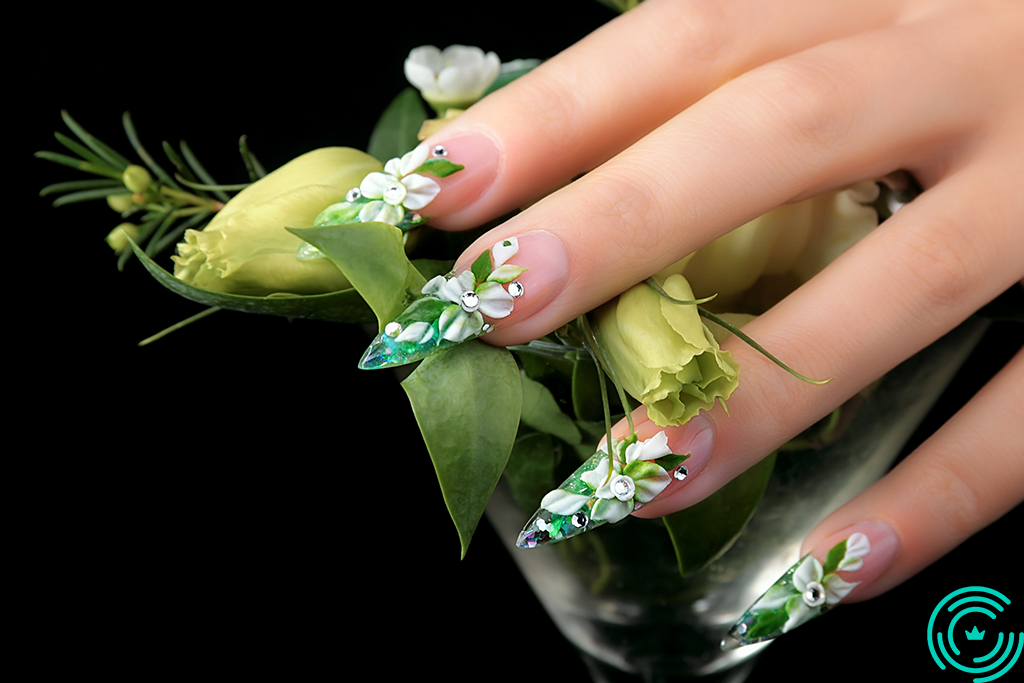 Woman's hand with long, sharp nails, with 3D floral pattern, predominantly green