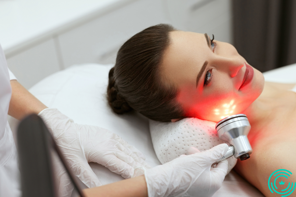 A woman in an esthetician's salon who gets laser treatment on her face